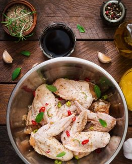 raw-marinated-chicken-wings-prepared-asian-style-with-honey-garlic-soy-sauce-herbs-top-view_2829-6339