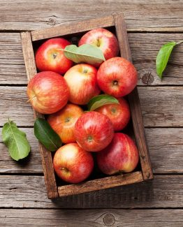 Ripe red apples in wooden box. Top view with space for your text; Shutterstock ID 1115705399
